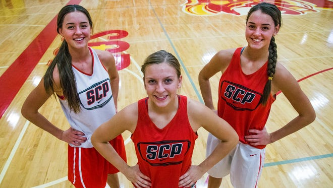 Members of the Seton Catholic High School girls basketball team from left to right: LeeAnne Wirth, Liz Holter and Jenn Wirth.