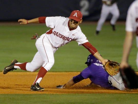 LSU's Alex Bregman steals second base against Arkansas'