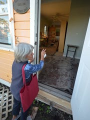 Marya Repko, president of the Everglades Society for Historic Preservation, shows a house targeted for the historic village. The society is proposing to move buildings damaged by Hurricane Irma to a central location to create an historic village showcasing the pioneer culture of Everglades City.