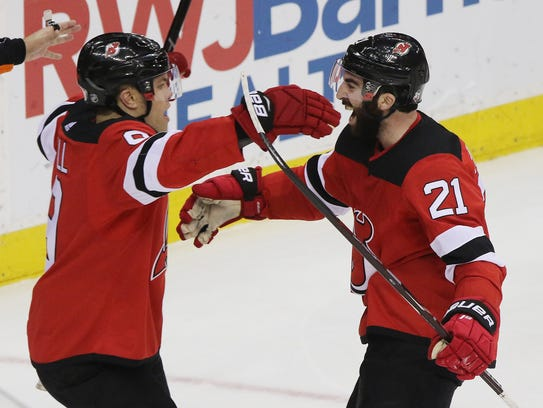 Taylor Hall and Kyle Palmieri celebrate a third period