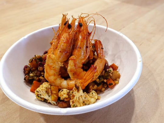 The Navarro bowl with grains, beans, roasted vegetables and grilled shrimp at Pa'La