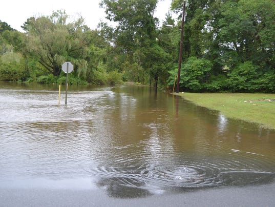 Up to 8 inches of rain cause flooding on lower shore - The water street magical town in holland ...