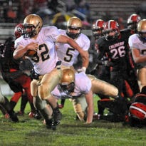 Lancaster's Ryan Fitchpatrick finds the open field and breaks a big run for the Golden Gales Friday night, Oct. 2, 2015, Groveport. The Gales won the game to remain undefeated on the season.