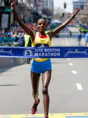 Apr 18, 2016; Boston, MA, USA; Atsede Baysa of Ethiopia breaks the tape to win the 120th Boston Marathon. Mandatory Credit: Greg M. Cooper-USA TODAY Sports
