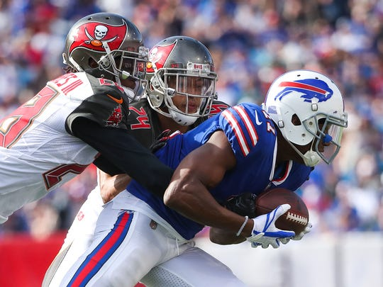 ORCHARD PARK, NY - OCTOBER 22:  Vernon Hargreaves #28 of the Tampa Bay Buccaneers and Brent Grimes #24 of the Tampa Bay Buccaneers tackle Zay Jones #11 of the Buffalo Bills during the second quarter of an NFL game on October 22, 2017 at New Era Field in Orchard Park, New York.  (Photo by Tom Szczerbowski/Getty Images)
