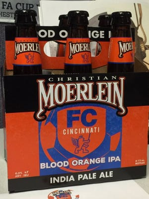 "Christian Moerlein Brewing Co. and the Moerlein Lager House on Tuesday night unveiled the bottled version of its FC Cincinnati-themed ""Blood Orange IPA."" The beer, previously only offered on draft, is available in bottles at the Lager House at 115 Joe Nuxhall Way as part of a limited run of 500 cases."