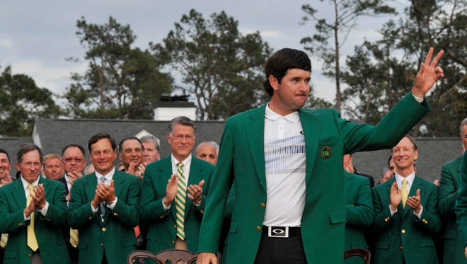 Bubba Watson celebrates with the green jacket after winning the 2014 Masters golf tournament at Augusta National Golf Club.