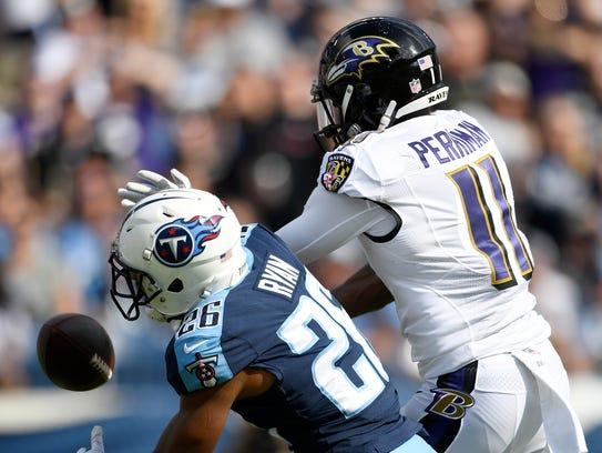 Titans cornerback Logan Ryan (26) breaks up a pass