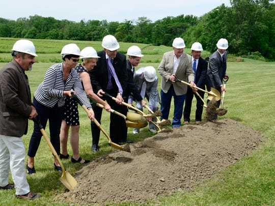 Officials take part in the ceremonial groundbreaking for Terra State Community College's $14.5 million student housing project.
