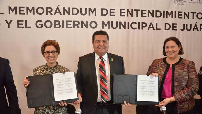 "Juarez, USAID and U.S. consulate officials signed a memorandum of understanding to participate in the ""Together Toward Violence Prevention"" program to help curb crime in Juarez."