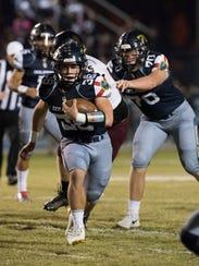 Gulf Breeze High School's Tyler Dittmer, (No. 36) finds