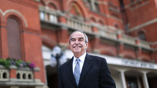 Robert Porco is in his 25th year as the Director of Choruses for the Cincinnati May Festival. He is photographed in front of Music Hall in Over-the-Rhine.