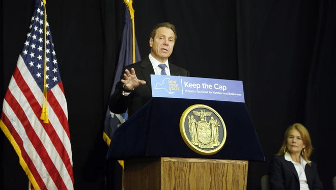 "Governor Andrew M. Cuomo speaks about the property tax cap as Nyack Mayor Jen White looks on during a ""Keep the Cap"" event at the Nyack Center, June 3, 2015."