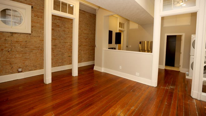 The living room area in a two-bedroom unit at the new Branderyhaus Apartments on Walnut Street.