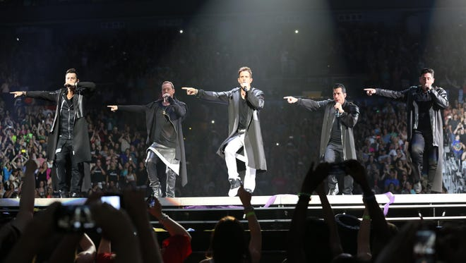 New Kids on the Block members, from left, Jordan Knight, Donnie Wahlberg, Joey McIntyre, Danny Wood and Jonathan Knight, perform in concert.