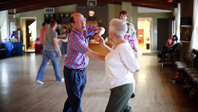 "Bill Armstrong dances with Evie Mitchell on June 18 at the Des Moines Ballroom. He has kept his promise to his late wife, Ronda, to ""keep dancing."""