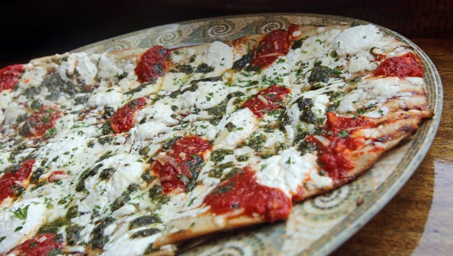 Pure bliss pizza is made with fresh mozzarella, ricotta, tomato, and basil pesto is served at Coals Pizza in Bronxville Aug. 3, 2015.
