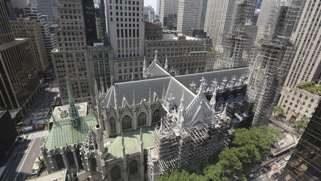 St. Patrick's Cathedral is surrounded in scaffolding in New York. A three-year restoration project at the cathedral is coming to an end, just in time for a late September visit from Pope Francis.