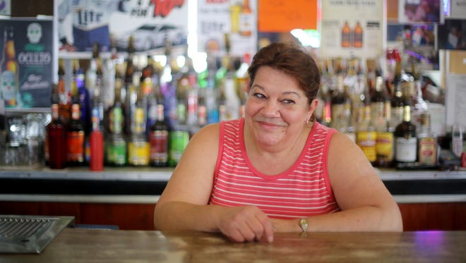 Lynda Meineke, John Boehner's sister, bartends at Andy's Cafe in Carthage. The bar, now owned by Vicky Bauer, was owned by the Boehner family for decades. John Boehner famously swept its floors as a youngster.