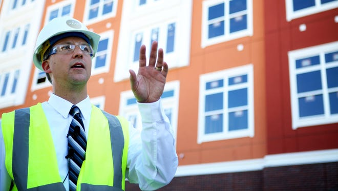 Kevin Cedik, general manager of Liberty Center, gives a walking tour of the $350 million mixed-use project in Butler County.