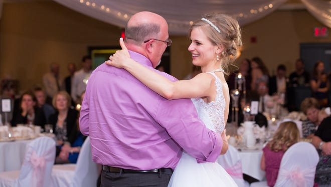 Greta Perske dances with Danny Daniels — her marrow donor when she was undergoing treatment for leukemia in 2007 —- at her wedding reception Oct. 10 at Kelly Inn in St. Cloud.
