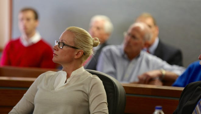 Crysta Pleatman listens to her attorney deliver closing arguments in a criminal case that stems from an Indian Hill home deal gone bad.