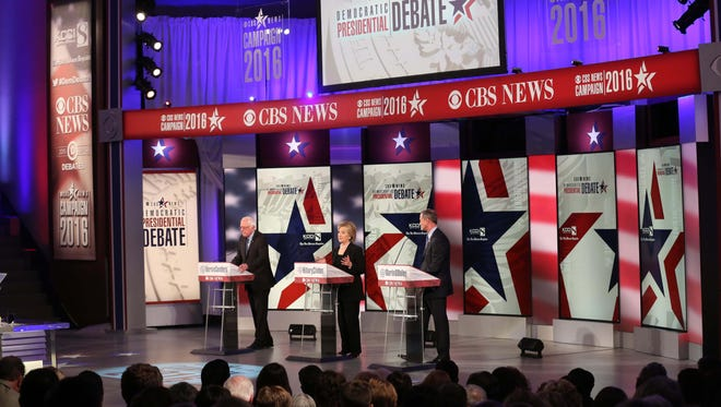 Bernie Sanders, Hillary Clinton and Martin O'Malley take part in the Democratic presidential debate at Drake University in Des Moines, Iowa, on Nov. 14, 2015.