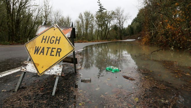 High water along Old Fort Road south of Monmouth on Tuesday, Dec. 8, 2015, in Polk County, Ore.