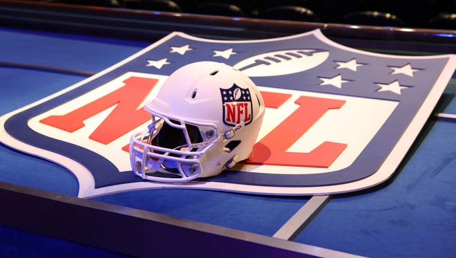 A general view of a helmet and NFL shield logo before the start of the 2014 NFL Draft at Radio City Music Hall.