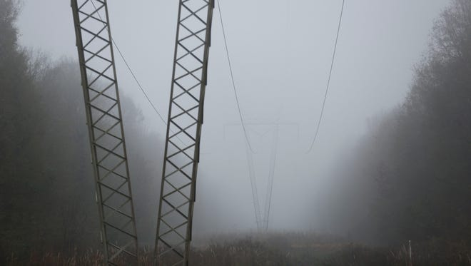 Heavy fog blankets a wooded area, Tuesday, Dec. 22, 2015, in Sandersville, Miss. A weather pattern that could be associated with El Nino has turned winter upside-down across the U.S. during a week of heavy holiday travel, bringing spring-like warmth to the Northeast, a risk of tornadoes in the South.
