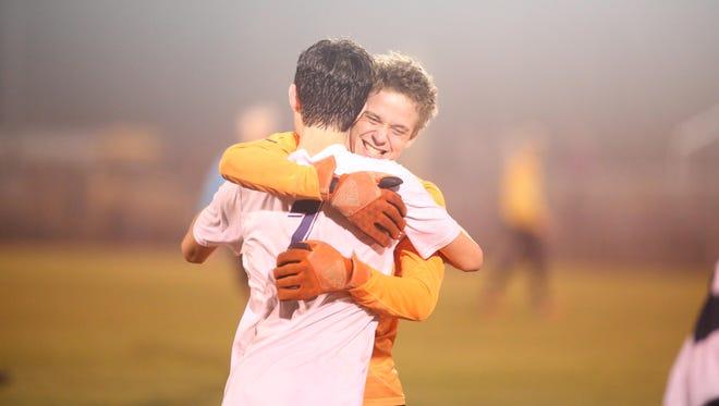 Wakulla goalie Cameron Briggs hugs teammate Matt Warnock after the War Eagles locked up a 2-1 win over Florida High in Tuesday night's Region 1-2A semifinal.