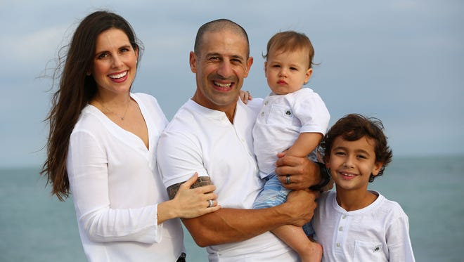 2013 Indianapolis 500 winner Tony Kanaan with his wife, Lauren, and sons Deco and Leo.