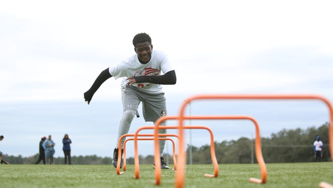 Cobb Middle School seventh grader Khamari Brown performs a footwork drill during a Florida FSG 7-on-7 tryout on Saturday, Feb. 6.