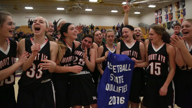 The Mount Ayr girls' basketball team celebrates after beating Grand View Christian 56-51 in the Class 1A regional final to advance to the state tournament on Monday.