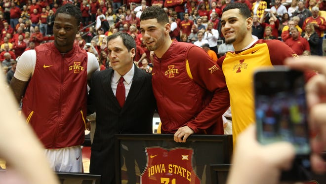 Iowa State seniors, Jameel McKay, Georges Niang, and Abdel Nader pose for a photo with coach, Steve Prohm before Iowa State's final home game of the season against Oklahoma State on Monday, Feb. 29, 2016, in Hilton Coliseum.