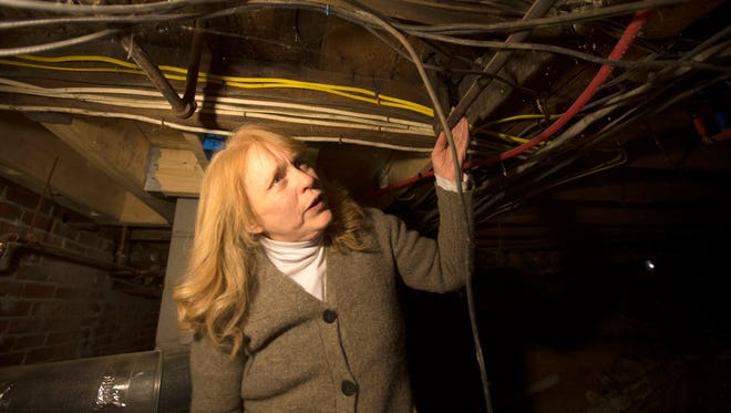 Nancy Beliveau shows off the plumbing underneath her home in Auburn, Maine. She received an elevated lead notice in mail, but ignored it because she was under the impression it didn't affect her street.