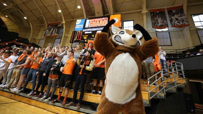 Silverton fans cheer as the Foxes defeat Bend 44-22 in the first round of the OSAA Class 5A state basketball tournament Wednesday, March 9, 2016, at Gill Coliseum in Corvallis.