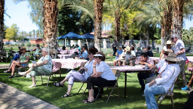 Heritage Festival goers listen to the Pennyroyal Players sing and perform at the Coachella Valley History Museum in Indio in 2015.