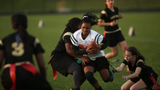 FAMU DRS seventh grader Erica Turral runs for a big gain before having her flag pulled by Florida High defenders during a game Tuesday night. Turral's speed will be a crucial asset for the Rattlers this season.