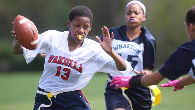 Wakulla's Ronnesha Thomas runs for a gain in a game against Wharton on Saturday morning in the Capital City Classic.