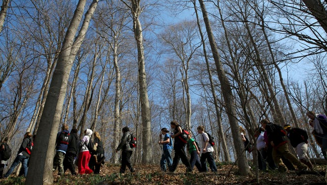 The Outdoor Adventure Club participate in a five mile hike at the Cincinnati Nature Center in Milford Saturday, March 21, 2015.