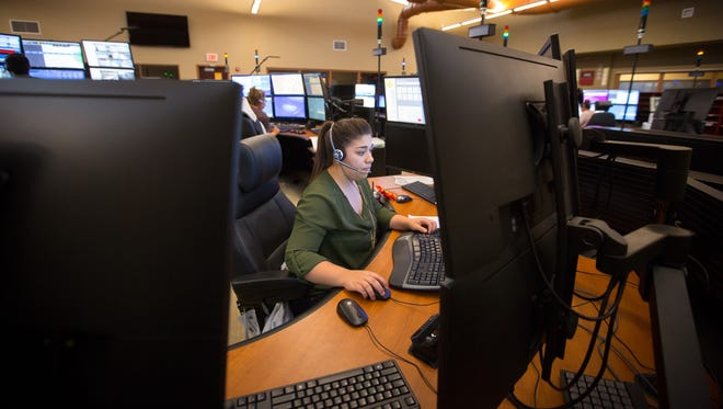 Dispatcher Alejandra Chavez takes a call at the new Mesilla Valley Regional Dispatch Authority, April 30, 2016. Chavez was one of 7 dispatchers working the day shift along with a supervisor, a typical number of employees during the day for the MVRDA.
