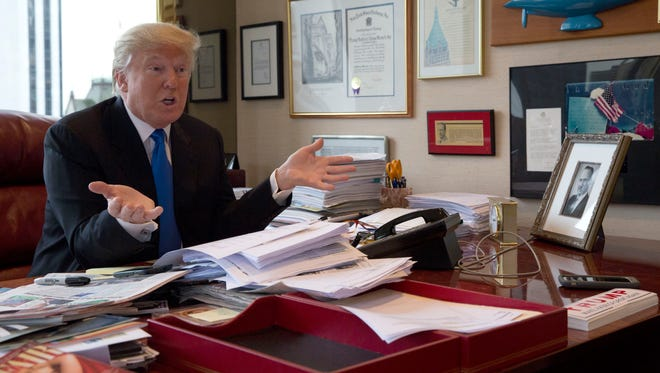 Republican presidential candidate Donald Trump speaks during an interview with The Associated Press in his office at Trump Tower in New York on May 10, 2016.