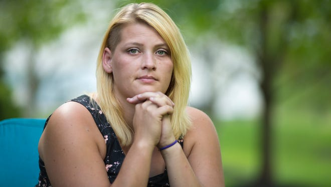 Krista Sizemore of Newport is photographed at her mother's home.