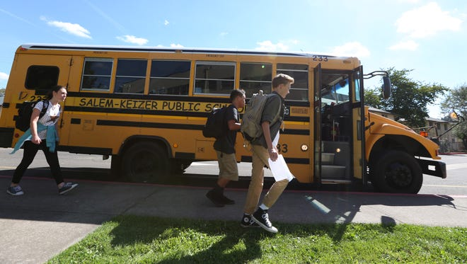 Students board buses at the end of the first day of classes on Wednesday, Sept. 7, 2016, at Walker Middle School in West Salem.