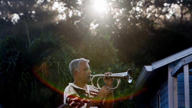 Adam Prentki plays the bugle call taps during the Bonita Springs Patriot Day Service at the Liles Hotel Plaza on Sunday, Sept. 11, 2016. The service included a 21-gun salute, the playing of taps, musical tributes and the sounding of a final alarm bell.