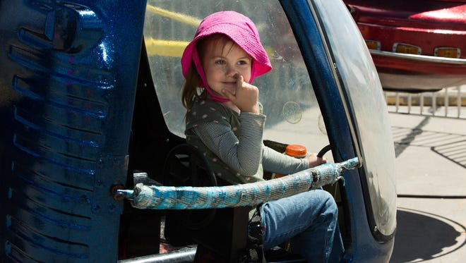 As this four-year-old finishes her ride she smiles to her mother and picks her nose.
