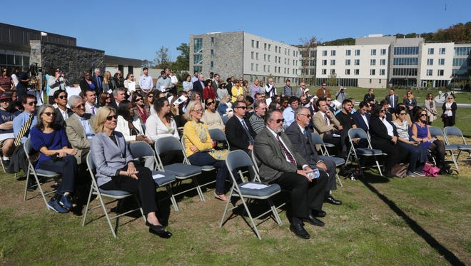 Attendees listen to speakers during a ceremony marking the official opening of Elm Hall, a new student dormitory at the Pace University's Pleasantville campus Oct. 6, 2016. The opening of Elm Hall marks the completion of the first phase in the university's master site plan.