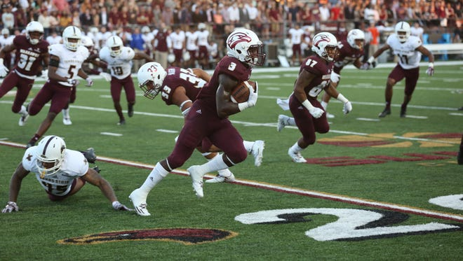 ULM wide receiver Marcus Green (3) returns a kickoff against Texas State on Saturday night at JPS Field at Malone Stadium.