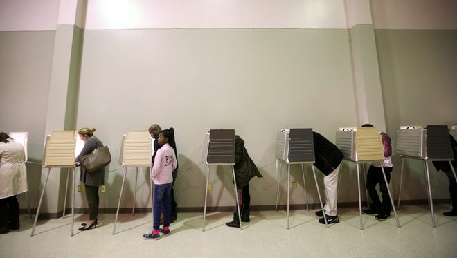 People vote inside of the New Life Temple Church, in Madisonville, on Tuesday, November 8.